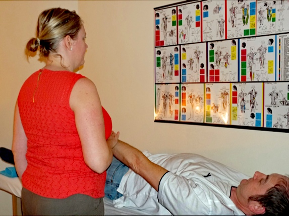 Holistic Therapist, treating a client.